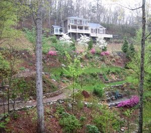 Access to steep slope garden with paths, steps, and terraces.