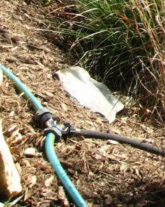 Steep slope gardening: soaker hose irrigation system with toggle connector
