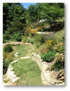 Regular maintenance keeps slope gardens tidy and healthy.