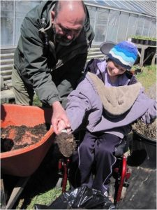 Gardener with special needs benefits from therapeutic program.