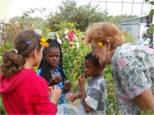 Sampling the produce from the School Garden with help from a Master Gardener.