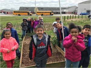 Children at Emma Elementary learn about veggie gardening.