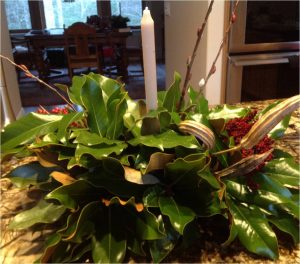 Holiday centerpiece of garden greenery